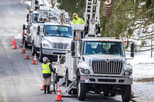 (Michael Bryant /The Philadelphia Inquirer via AP). Crews from 3Phase Line Construction, from Chicago, work on War Trophy Lane in Aston, Pa., to try to bring back power to the residential neighborhood on Thursday, March 8, 2018.