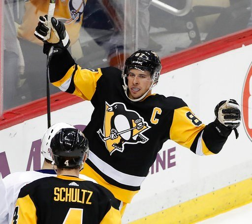 (AP Photo/Gene J. Puskar). Pittsburgh Penguins' Sidney Crosby (87) celebrates his winning goal in overtime of an NHL hockey game against the New York Islanders in Pittsburgh, Saturday, March 3, 2018.