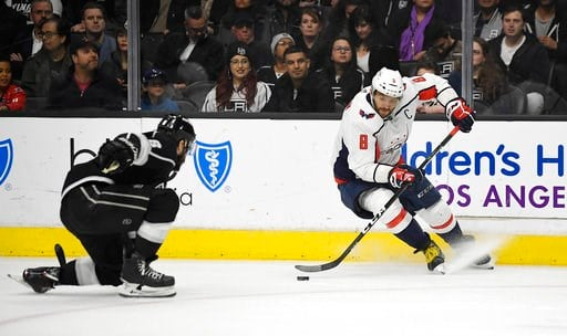 (AP Photo/Mark J. Terrill). Washington Capitals left wing Alex Ovechkin, right, of Russia, fakes out Los Angeles Kings defenseman Drew Doughty during the first period of an NHL hockey game, Thursday, March 8, 2018, in Los Angeles.