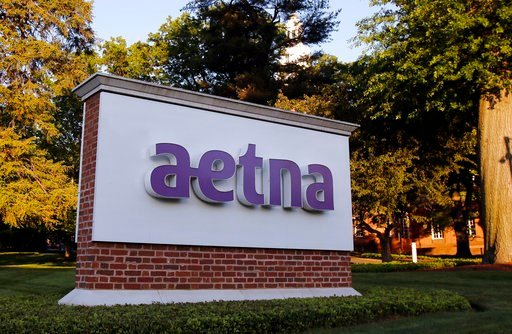 (AP Photo/Bill Sikes, File). FILE - In this June 1, 2017, file photo, a sign stands on the campus of the Aetna headquarters, in Hartford, Conn. Insurers are dropping billions of dollars on acquisitions and expansions as they get more involved in their ...