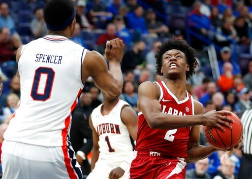 (AP Photo/Jeff Roberson). Alabama's Collin Sexton, right, heads to the basket as Auburn's Horace Spencer, left, defends during the second half in an NCAA college basketball quarterfinal game at the Southeastern Conference tournament Friday, March 9, 20...