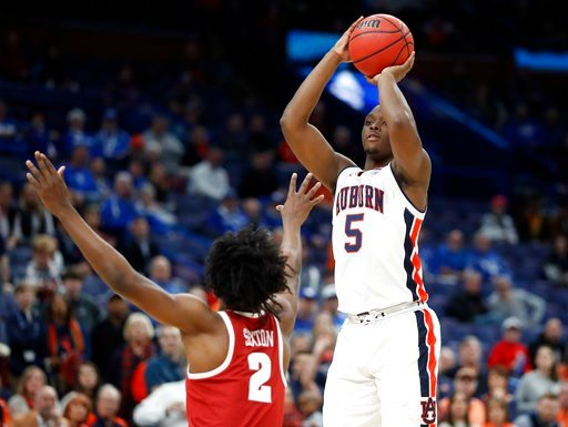 (AP Photo/Jeff Roberson). Auburn's Mustapha Heron (5) shoots over Alabama's Collin Sexton (2) during the first half in an NCAA college basketball quarterfinals game at the Southeastern Conference tournament Friday, March 9, 2018, in St. Louis.