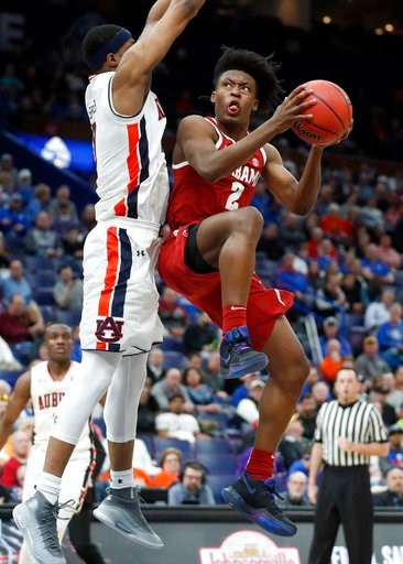 (AP Photo/Jeff Roberson). Alabama's Collin Sexton, right, heads to the basket as Auburn's Horace Spencer defends during the second half in an NCAA college basketball quarterfinal game at the Southeastern Conference tournament Friday, March 9, 2018, in ...