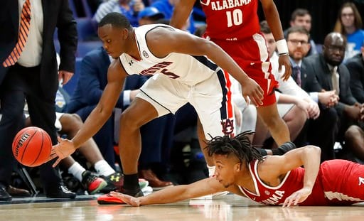 (AP Photo/Jeff Roberson). Auburn's Mustapha Heron, top, and Alabama's Dazon Ingram, reach for a loose ball during the first half in an NCAA college basketball quarterfinal game at the Southeastern Conference tournament Friday, March 9, 2018, in St. Lou...