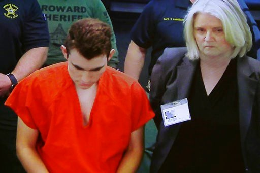 (Broward County Court/South Florida Sun-Sentinel via AP). In this image taken from a video monitor, Nikolas Cruz, center, a former student accused of opening fire at Marjory Stoneman Douglas High School on Feb. 14, appears in magistrate court via video...