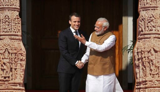 (AP Photo/Manish Swarup). Indian Prime Minister Narendra Modi, right, welcomes French President Emmanuel Macron at the International Solar Alliance founding conference in New Delhi, India, Sunday March 11, 2018. Modi and Macron on Sunday co-chaired the...