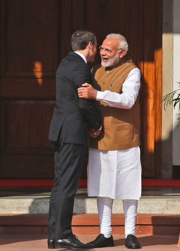 (AP Photo/Manish Swarup). Indian Prime Minister Narendra Modi, right, hugs French President Emmanuel Macron upon arrival for the International Solar Alliance founding conference in New Delhi, India, Sunday March 11, 2018. Modi and Macron on Sunday co-c...