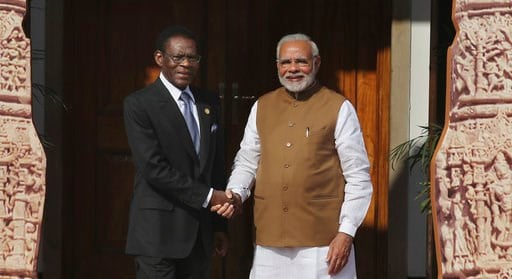 (AP Photo/Manish Swarup). Indian Prime Minister Narendra Modi, right, poses with Equatorial Guinea President Teodoro Obiang Nguema Mbasogo  for a photo at the International Solar Alliance founding conference in New Delhi, India, Sunday March 11, 2018. ...