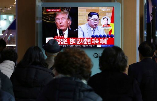 (AP Photo/Ahn Young-joon). People watch a TV screen showing North Korean leader Kim Jong Un and U.S. President Donald Trump, left, at the Seoul Railway Station in Seoul, South Korea, Friday, March 9, 2018. After months of trading insults and threats of...
