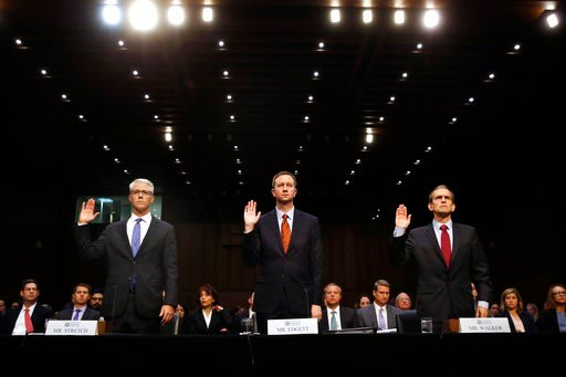 (AP Photo/Jacquelyn Martin, File). FILE - In this Nov. 1, 2017, file photo, from left, Facebook General Counsel Colin Stretch, Twitter Acting General Counsel Sean Edgett and Google Senior Vice President and General Counsel Kent Walker are sworn in for ...