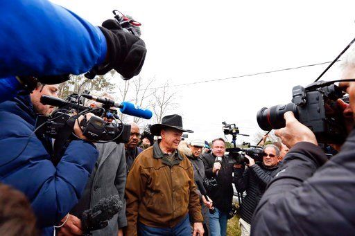 (AP Photo/Brynn Anderson, File). FILE - In this Tuesday, Dec. 12, 2017, file photo, journalists follow U.S. Senate candidate Roy Moore as he arrives to cast his vote in Gallant, Ala. December's U.S. Senate election in Alabama was rife with fake online ...
