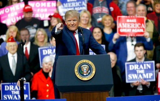 (AP Photo/Keith Srakocic). President Donald Trump reacts to the crowd while speaking at a campaign rally for Republican Rick Saccone in a hangar, Saturday, March 10, 2018, in Moon Township, Pa. Saccone is running against Democrat Conor Lamb in a specia...