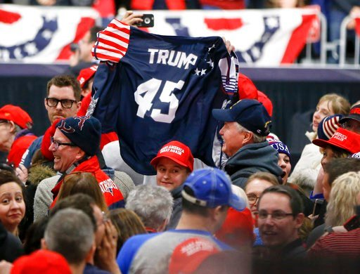 (AP Photo/Keith Srakocic). Supporters wave a jersey supporting President Donald Trump before he arrives for a campaign rally for Republican Rick Saccone, Saturday, March 10, 2018, in Moon Township, Pa. Saccone is running against Democrat Conor Lamb in ...