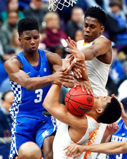 (AP Photo/Jeff Roberson). Kentucky's Hamidou Diallo (3) reaches for a rebound with Tennessee's Admiral Schofield, top right, and Grant Williams, bottom right, during the first half of an NCAA college basketball championship game at the Southeastern Con...
