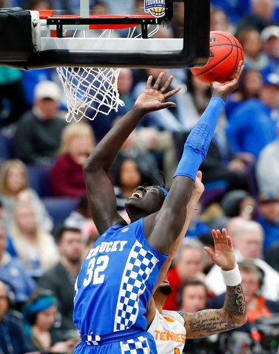 (AP Photo/Jeff Roberson). Kentucky forward Wenyen Gabriel (32) grabs a rebound during the first half of an NCAA college basketball game against Tennessee at the Southeastern Conference tournament championship Sunday, March 11, 2018, in St. Louis.