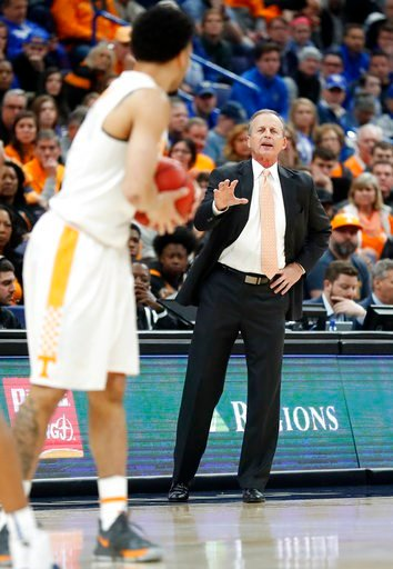 (AP Photo/Jeff Roberson). Tennessee head coach Rick Barnes, right, directs his players during the first half of an NCAA college basketball championship game against Kentucky at the Southeastern Conference tournament Sunday, March 11, 2018, in St. Louis.