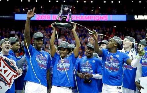 (AP Photo/Charlie Riedel). Kansas players celebrate after winning the NCAA college basketball championship game against West Virginia in the Big 12 men's tournament Saturday, March 10, 2018, in Kansas City, Mo. Kansas won 81-70.