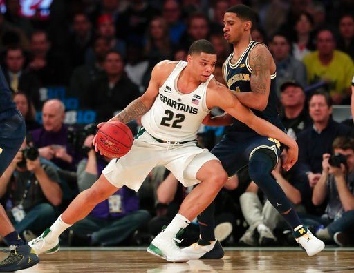 (AP Photo/Julie Jacobson). Michigan State guard Miles Bridges (22) drives against Michigan guard Charles Matthews (1) during the second half of an NCAA Big Ten Conference tournament semifinal college basketball game, Saturday, March 3, 2018, in New Yor...