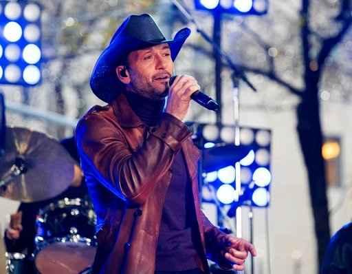 """(Photo by Charles Sykes/Invision/AP, File). In this Nov. 17, 2017, file photo, Tim McGraw performs on NBC's """"Today"""" show at Rockefeller Plaza in New York."""