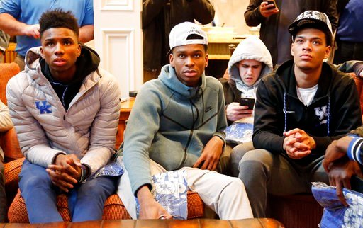 (AP Photo/James Crisp). Members of the Kentucky basketball team, from left, Hamidou Diallo, Shai Gilgeous-Alexander, Brad Calipari and Quade Green watch the NCAA Tournament selection show at the home of head coach John Calipari Sunday, March 11, 2018.