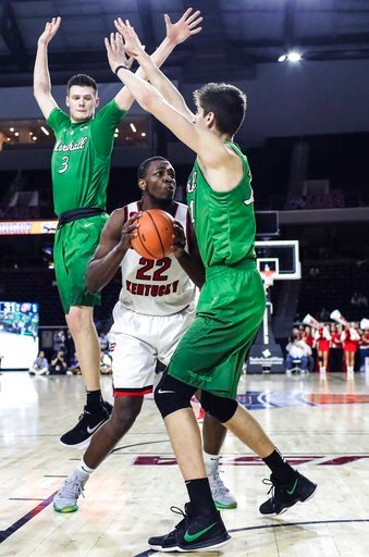 (Austin Anthony/Daily News via AP). Western Kentucky forward Dwight Coleby (22) looks to shoot while guarded by Marshall forwards Jannson Williams (3) and Ajdin Penava (11) during an NCAA college basketball game for the Conference USA men's tournament ...