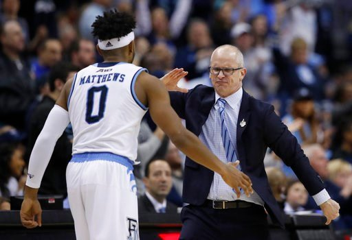 (AP Photo/Alex Brandon). Rhode Island head coach Dan Hurley, right, celebrates a play with guard E.C. Matthews during the first half of an NCAA college basketball championship game against Davidson in the Atlantic 10 Conference tournament, Sunday, Marc...