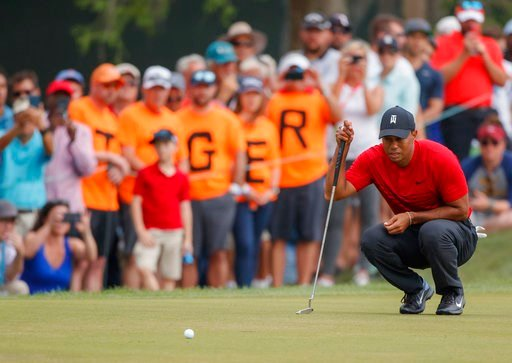 (AP Photo/Mike Carlson). Tiger Woods lines up a putt on the 13th hole during the final round of the Valspar Championship golf tournament Sunday, March 11, 2018, in Palm Harbor, Fla.