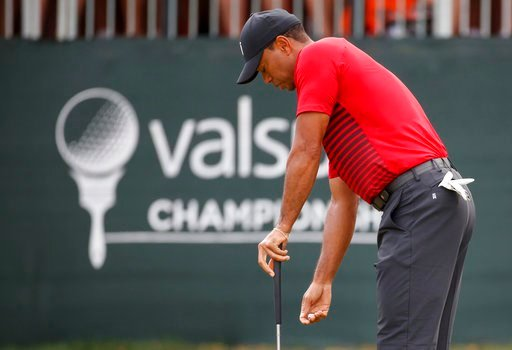 (AP Photo/Mike Carlson). Tiger Woods reacts to a missed putt on the 12th hole during the final round of the Valspar Championship golf tournament Sunday, March 11, 2018, in Palm Harbor, Fla.