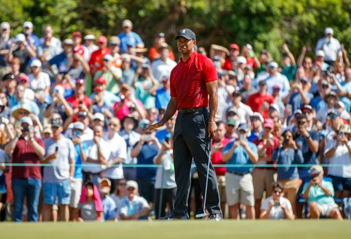 (AP Photo/Mike Carlson). Tiger Woods reacts to a missed putt on the sixth hole during the final round of the Valspar Championship golf tournament Sunday, March 11, 2018, in Palm Harbor, Fla.