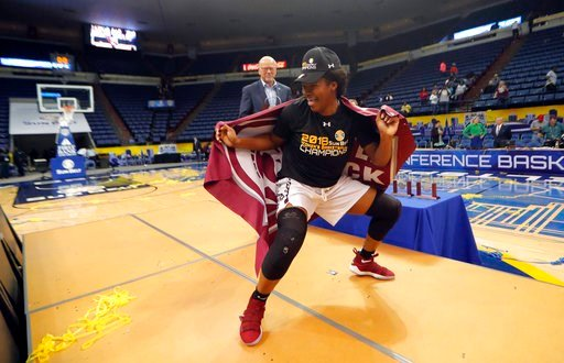 (AP Photo/Gerald Herbert). Arkansas Little Rock forward Ronjanae DeGray dances with a school flag as she is called up to receive her all-tournament team trophy, after they defeated Texas State in the Sun Belt Conference NCAA college basketball champion...