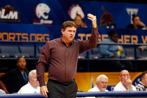(AP Photo/Gerald Herbert). Arkansas Little Rock head coach Joe Foley calls out to his team from the bench in the second half of the the Sun Belt Conference NCAA college basketball championship game against Texas State in New Orleans, Sunday, March 11, ...