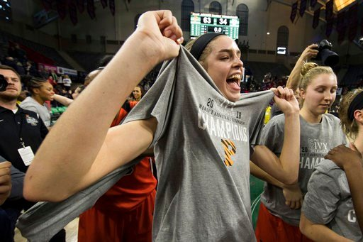 (AP Photo/Chris Szagola). Princeton's Bella Alarie reacts with her new T-shirt as she celebrates after an NCAA college basketball championship game against Pennsylvania in the Ivy League Tournament, Sunday, March 11, 2018, in Philadelphia.