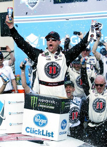 (AP Photo/Rick Scuteri). Monster Energy NASCAR Cup Series driver Kevin Harvick (4) celebrates after winning a NASCAR Cup Series auto race on Sunday, March 11, 2018, in Avondale, Ariz.