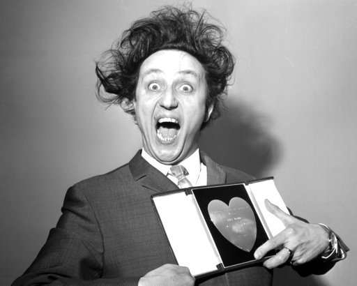 (PA via AP, File). FILE - In this March 8, 1966 file photo, comedian Ken Dodd poses with his award for Show Business Personality of the Year, presented to him at the Variety Club's luncheon at the Savoy Hotel, London. British comedian Ken Dodd, whose s...