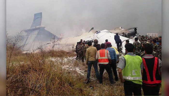 An airport official says a US-Bangla Airlines passenger plane has crashed as it landed at Kathmandu airport. (Shrada/ @shradhagb, Dan Ayliffe/Twitter, Saroj Basnet/Twitter/CNN)