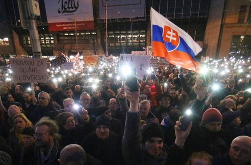 (AP Photo/Ronald Zak). Demonstrators light with the the torches of their smartphones during an anti-government rally in Bratislava, Slovakia, Friday, March 9, 2018. The country-wide protests demand a thorough investigation into the shooting deaths of J...