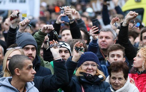 (AP Photo/Ronald Zak). Demonstrators show their key chains during an anti-government rally in Bratislava, Slovakia, Friday, March 9, 2018. The country-wide protests demand a thorough investigation into the shooting deaths of Jan Kuciak and Martina Kusn...