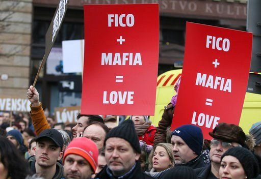 (AP Photo/Ronald Zak). Demonstrators hold posters linking Slovakian Prime Minister Robert Fico to the mafia during an anti-government rally in Bratislava, Slovakia, Friday, March 9, 2018. The country-wide protests demand a thorough investigation into t...