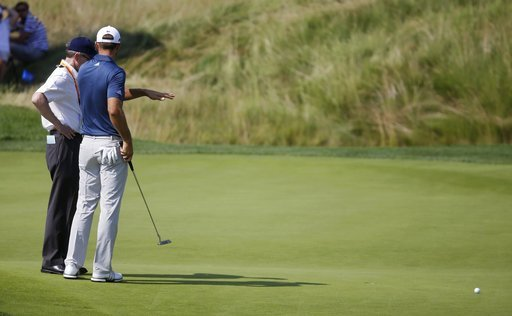 (AP Photo/John Minchillo, File). FILE - In this June 19, 2016, file photo, Dustin Johnson, right, talks to a rules official on the fifth green during the final round of the U.S. Open golf tournament at Oakmont Country Club in Oakmont, Pa. The USGA and ...