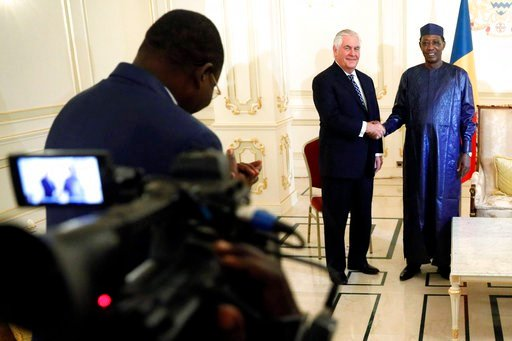 (Jonathan Ernst/Pool via AP). Chad's President Idriss Deby welcomes U.S. Secretary of State Rex Tillerson at the Presidential Palace in N'Djamena, Chad, Monday, March 12, 2018.