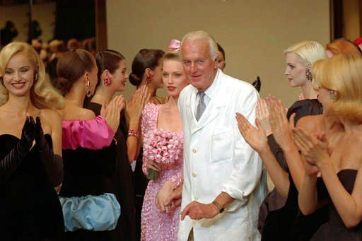 (AP Photo/Lionel Cironneau). FILE - In this July 11 1995 file photo, French designer Hubert de Givenchy is applauded by his models after his 1995-96 fall-winter haute couture fashion collection in Paris. French couturier Hubert de Givenchy, a pioneer o...