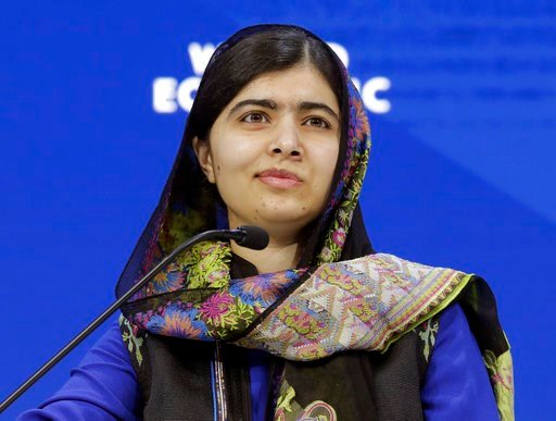 (AP Photo/Markus Schreiber, File). FILE- In this Jan. 25, 2018 file photo, Nobel laureate Malala Yousafzai attends the annual meeting of the World Economic Forum in Davos, Switzerland. Little, Brown Books for Young Readers told The Associated Press on ...