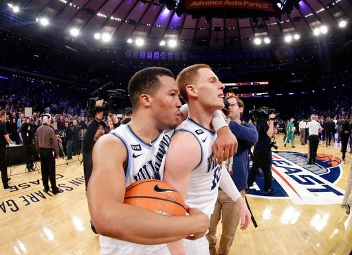 (AP Photo/Frank Franklin II). Villanova's Jalen Brunson, left, celebrates with Donte DiVincenzo after the team's NCAA college basketball game against Providence in the Big East men's tournament final Saturday, March 10, 2018, in New York. Villanova won...