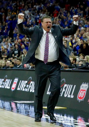(AP Photo/Charlie Riedel). Kansas head coach Bill Self celebrates after winning the NCAA college basketball championship game against West Virginia in the Big 12 men's tournament Saturday, March 10, 2018, in Kansas City, Mo. Kansas won 81-70.
