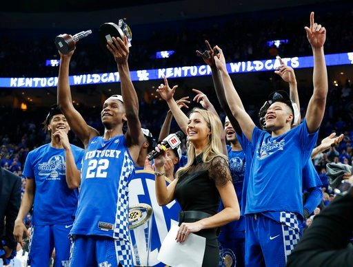 (AP Photo/Jeff Roberson). Kentucky players celebrate after beating Tennessee 77-72 in an NCAA college basketball championship game at the Southeastern Conference tournament Sunday, March 11, 2018, in St. Louis.