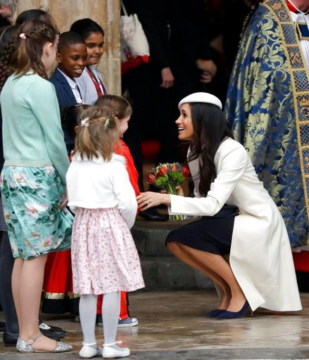 (AP Photo/Kirsty Wigglesworth, pool). Meghan Markle receives flowers as she leaves after attending the Commonwealth Service at Westminster Abbey in London, Monday, March 12, 2018. Organised by The Royal Commonwealth Society, the Commonwealth Service is...