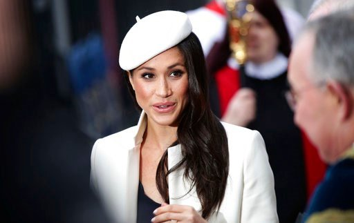 (Yui Mok/PA via AP). Britain's Prince Harry's fiancee Meghan Markle leaves the Commonwealth Service at Westminster Abbey, London Monday March 12, 2018.