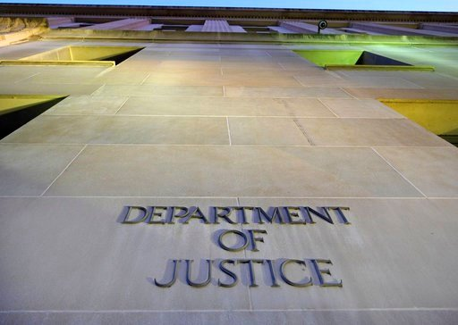 (AP Photo/J. David Ake, File). FILE - In this May 14, 2013, file photo, the Department of Justice headquarters building in Washington is photographed early in the morning. The federal government censored, withheld or said it couldn't find records sough...