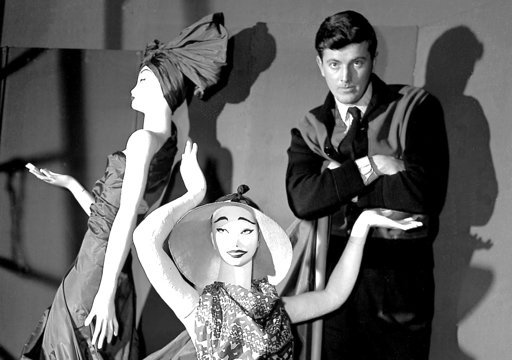 (AP Photo, File). FILE - In this Feb.1 1952 file photo, French fashion designer Hubert de Givenchy poses with mannequins in his shop in Paris. French couturier Hubert de Givenchy, a pioneer of ready-to-wear who designed Audrey Hepburn's little black dr...