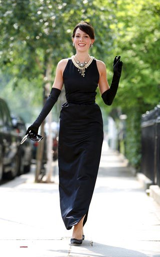 "(AP Photo/Christopher Pledger, File). FILE- In this July 26, 2006, file photo, model Romilly Collins wears the black Givenchy dress made for actress Audrey Hepburn in the classic 1961 film ""Breakfast at Tiffany's"" in central London. French couturier Hu..."